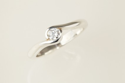 Fairtrade Gold Engagement ring - 2 wave holding a Jeweltree diamond