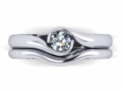 Fairtrade Gold Engagement ring - 2 wave holding a Jeweltree diamond - April Doubleday - The Ethical Jeweller.